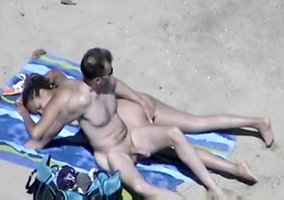 sexually slutty wife with large bazookas on beach